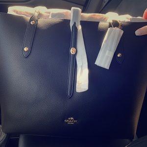 Brand new black coach purse. Never used.
